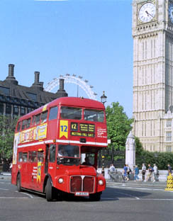 A classic London Routemaster bus around the Houses of         Parliament